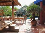 Shared outdoor dining area and gazebo by the pool