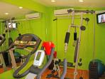 Small airconditioned gym with everything you need for a good wor