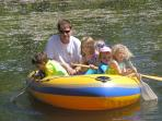 KIDS ENJOY THE RUBBER RAFT ON THE SWIMMING POND!