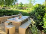 Have breakfast at the outdoor dining table in the shade of the willow tree