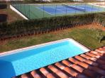 Terrace over looking pool and tennis court