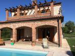 Open Terrace and Pool with Sun Loungers and Dining Area