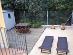 Jardín privado con solarium.
