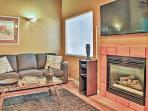 Snuggle up next to the fireplace and watch your favorite show on the large flat screen TV