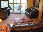 Living Room with Queen Sofa Sleeper, Flat Screen TV, Electric Fireplace, screened patio access