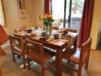 Enjoy family meals gathered around this dining table.