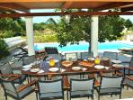 Al fresco dining by the pool for up to 12.  Outdoor kitchen and bar area just a few steps away