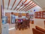 Large diningroom area with a completely equipped kitchen