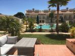 Patio overlooking pool and gardens