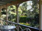 View north west from north east verandah. Breakfast tables for Tinbeerwah Room and Pinbarren Room.