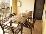 Spacious veranda with wooden furniture. Amazing sea view. Lovely birdsongs with your morning coffee