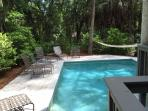 Enjoy the pool in the water, on a chair, lounge or on the hammock!