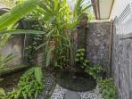 The bathroom of Matahari room has open space shower.