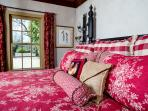 Luxury french country linens on 4 poster King Bed.