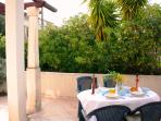 Large dining terrace surrounded by plants