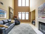 living room, high ceilings, sunset view, pull out sofa bed couch, reclyner
