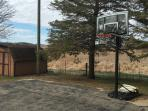 large driveway with basketball hoop