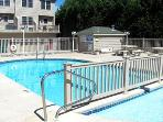 pool is spacious with nice tables and benches and separate children's pool area