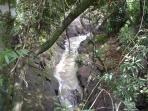 The cascading river that boarders the B & B on the N. side. The sound is beautiful on the deck--