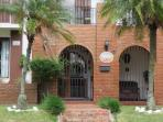 Our Front entrance w/ the Royal Palms & the ceramic Cariari B & B Plaque