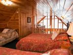 THE LOFT BEDROOM HAS 2 QUEEN BEDS AND 2 TWIN BEDS PLUS A VIEW AND A BATHROOM