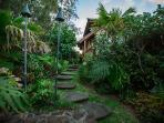 You can access the private guest suite through the tropical beauty of nature!