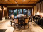 An additional eating area is located overlooking the living room, with a view of the courtyard