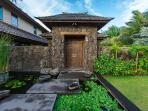 The entry gate is built with wooden doors imported from Bali.