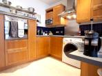 And the kitchen is fully equipped with an oven, hob with four hot plates