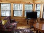 Muskoka room, windows all around, tv, DVD, card table.