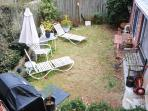 Relaxe! Fenced-in back yard with lounge chairs, propane grill, and  beautiful plants!