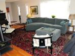 Spacious living room with a HUGE, comfy couch, large-screen TV with cable/Amazon Stick, & piano