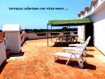terrazzo solarium di mq 200 con una bellissima vista sulla macchia mediterranea  e vista mare
