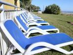 Oceanfront lawn sunbathing