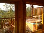 Hot tub on the deck overlooking the mountains