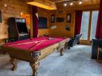 Game Room: 8' tournament style Pool Table and Arcade with 60 video games to play.