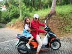 Au, our guest relations manager, making her rounds through Santithani on motorbike