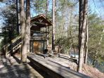 View from deck of fire pit , hot tub and steps to the river.