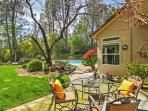 The backyard space is beautifully landscaped.