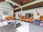 Living Room. Confortable lounges and TV and sound system system. Open large space. Kitchen