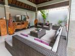 Large living room. Chaiselong and single sofas. Confortable space. Tv and Sound system