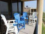 Balcony seating, top floor, corner unit. Great beach view.