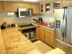 Roomy kitchen, fridge with ice maker.
