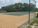 Community tennis court recently resurfaced and back board added for practice,key fob given at checkn