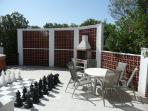 BBQ area with giant chessboard