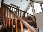 Stairs up to the loft