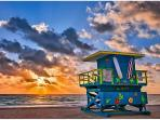 Sunrise over South Beach lifeguard stand.