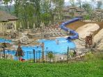 Pool area in the summer, with waterslide