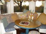 Cozy breakfast nook easily seats 4 to 5 with 2 stools for added guests.  The table is freestanding