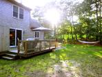 private back yard with deck and outdoor shower